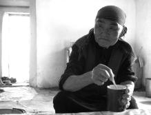Woman drinking kumis in the jailoo, 2008