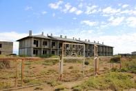 Abandoned, unfinished hotel, Barbulak beach camp, 2013